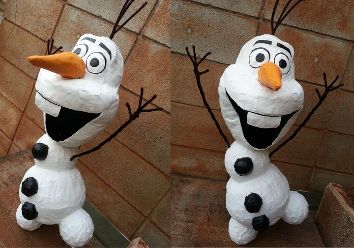 Paper mache Olaf from Frozen. Started off as a pinata for a first birthday. Ended up being a centerpiece display.