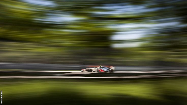 Lewis Hamilton's McLaren creates a blur of colour through the trees of Montreal's Ile Notre Dame on the way to victory in the Canadian Grand Prix  BBC Sport - Formula 1 big picture by leading photographer Darren Heath