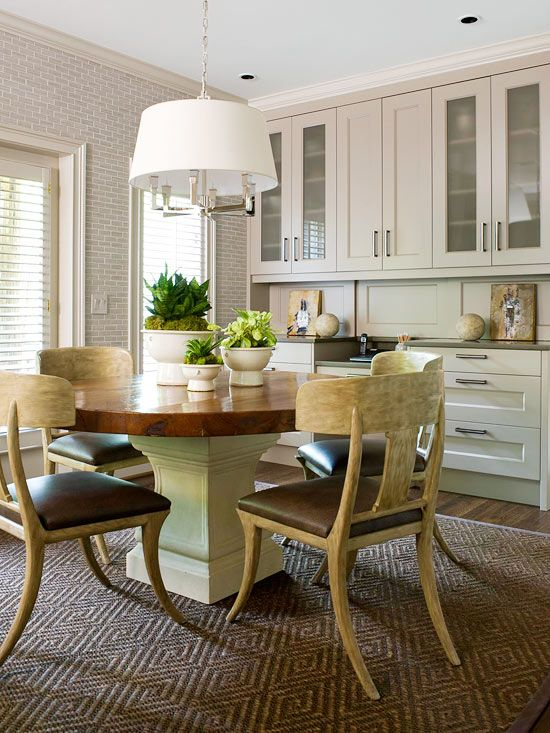 Subway tile wallpaper, rustic dining table with white pedestal base, modern pendant light or chandelier, eat-in kitchen, room.