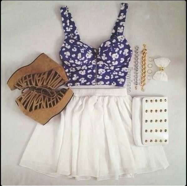 Blue croptop and a white skirt with accessories  and a pair of leather wedge sandles