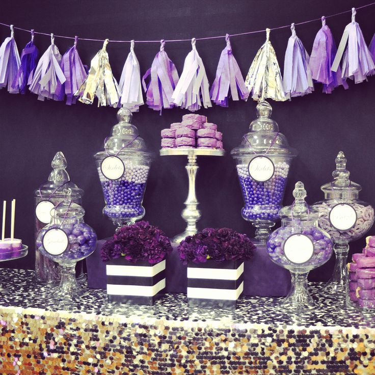 Purple candy bar, silver sequins table linen, black and whit stripe vases. Dessert table.