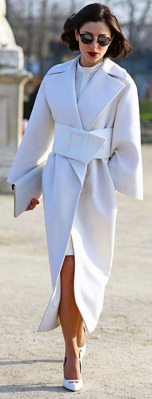 With its oversized features this white Taylor Coat is absolutely stunning. The bold lines and simple style exude high fashion. Seen here with a red lip, simple pumps, retro glasses, and large clutch. @TwinsNextDoor