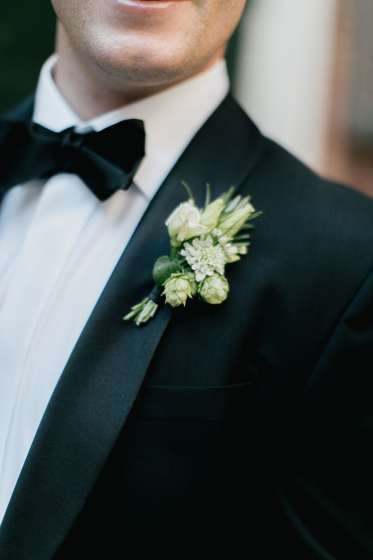 Green and white boutonniere featuring hops.  Grown and designed by Love 'n Fresh Flowers.