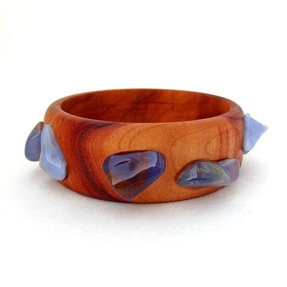 Wooden Bracelet featuring blue chalcedony stones embedded into an arbutus or strawberry tree wood bracelet.  This particular piece of arbutus