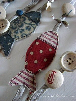 Fabric fish and buttons to make garland - good idea for decorating the Christmas tree at the lake house