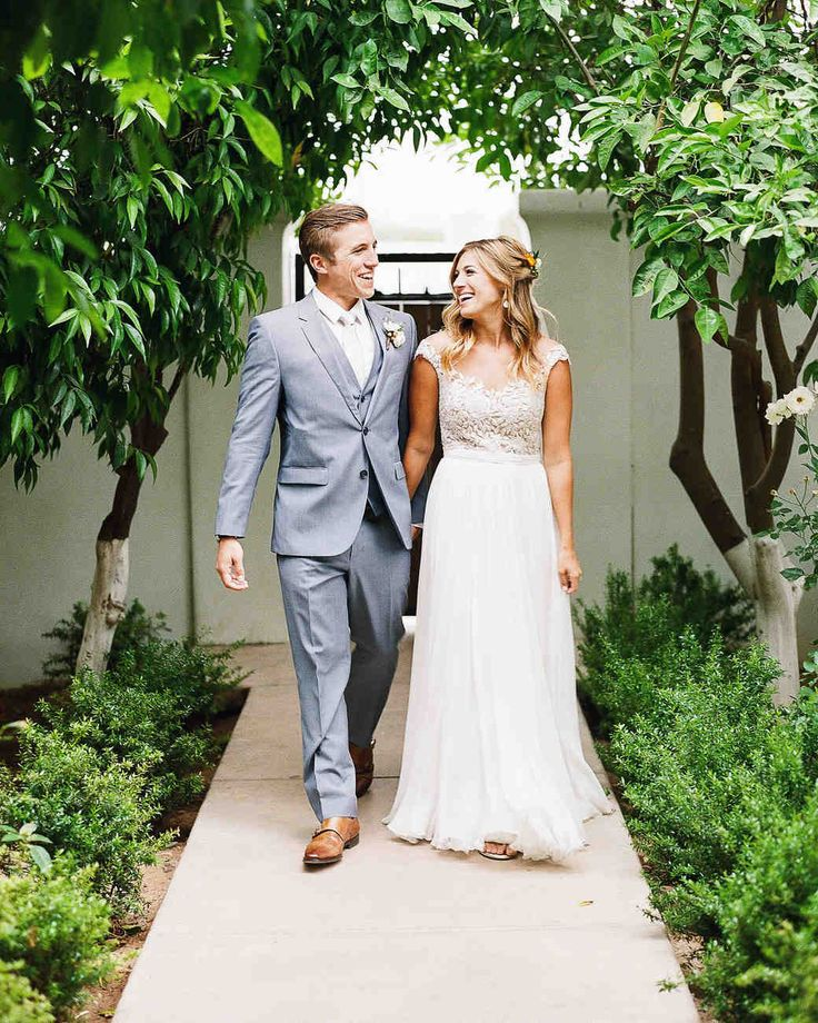 A Bright Wedding in Arizona with Boho Touches | Martha Stewart Weddings - The bride was very set on what her wedding dress would be—a lace, bohemian-style number, cut low in the back, without a long train, and with absolutely no beads. However, when she tried on a Reem Acra gown, Aubrey recalls that everyone started crying and she knew it was the one. Funnily enough, it wasn't low cut and was fully beaded on the top. She topped off her look with a short, simple veil.