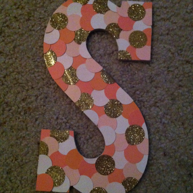 My creation! Wooden letter from Michaels and free paint chips from  Lowes. Perfect for my dorm door :)