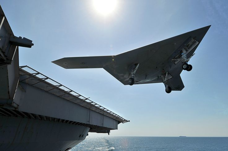US Navy's unmanned X47-B jet lands on aircraft carrier for the first time.