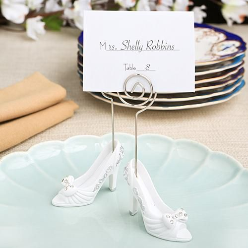 fairytale shoe wedding place card holder features a base made of white poly resin it