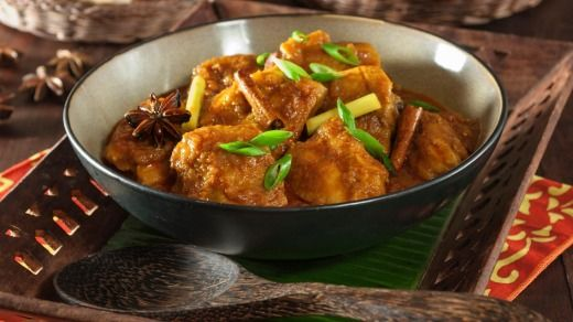 Ayam masak merah: Red cooked chilli chicken.