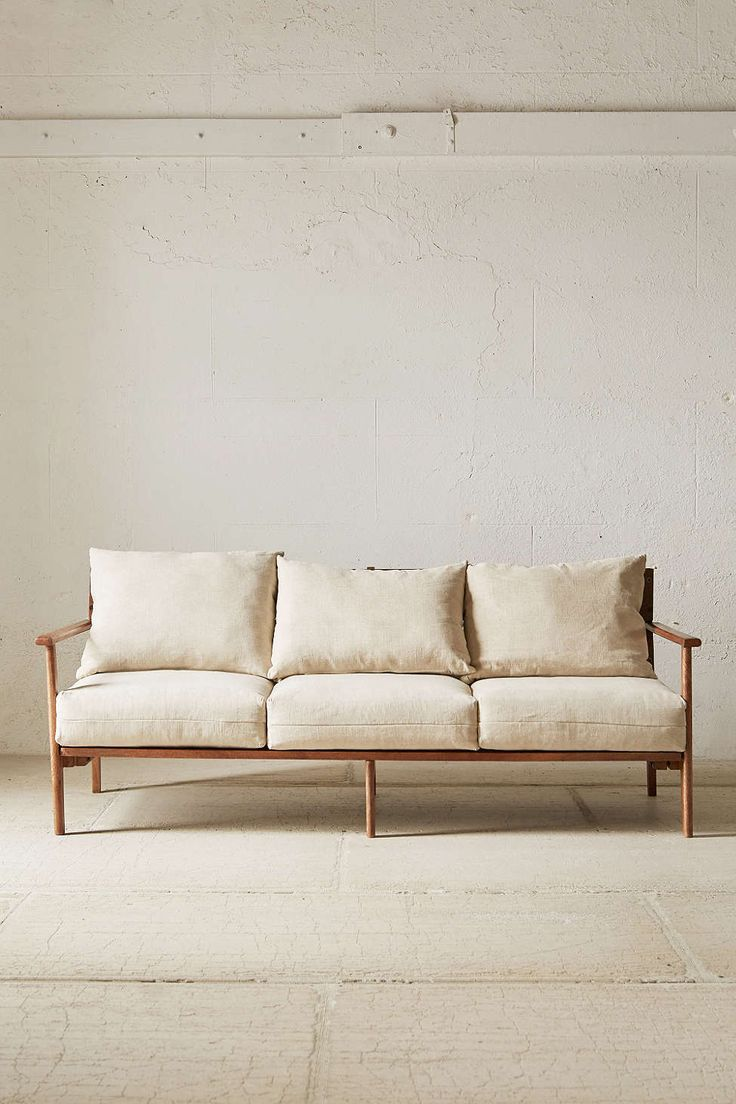 like - the scandinavian shape, the empty armrests and skeleton, the big cushions, perhaps in a different colour