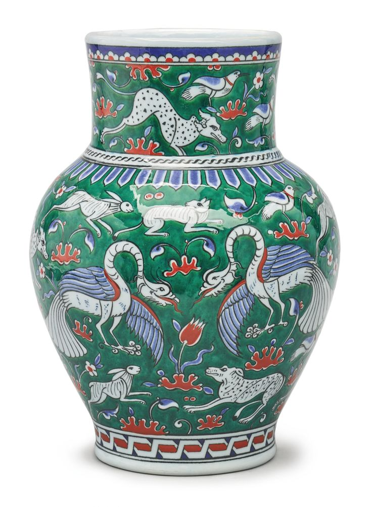 A TURKISH IZNIK-STYLE POTTERY GREEN-GROUND VASE, MODERN in 16th-century Iznik style, blue painted artist's mark, height 11 3/4 in | sotheby's