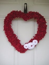 Upcycled T-Shirt Heart Wreath tutorial by Crystal's Craft Spot. At first glance, you'd never guess that this beautiful Valentine wreath was made out of an old t-shirt!