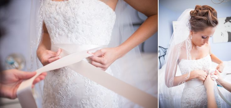 Bride tying her sash on her beautiful lace Monique Lhuillier gown