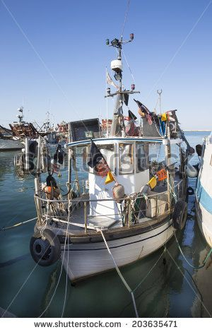SAN BENEDETTO DEL TRONTO, ITALY - JUN 3: fishing boats on jun 3, 2014  in the harbor of San Benedetto del Tronto, Italy - stock photo