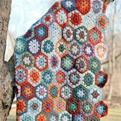 This handmade afghan, crocheted with an alpaca blend yarn, was inspired by the Garnet Hill Haverhill blanket. Basic pattern included. #craftgawker