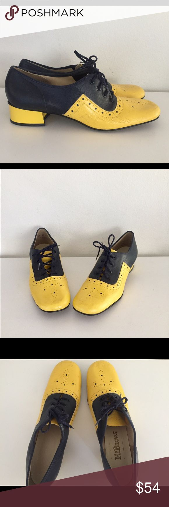 """Vintage 60s Spectators Mod Oxford Heels Wing Tip 8 60's oxford style lace up spectators in black and yellow.  The laces are leather and have tassels at the ends, the upper is leather, the inner and footbed is glove soft leather and they have a leather sole as well.  Material- manmade Maker: HiBrows Era: 60's  Size: 8AA  Length- 10"""" insole  Width- 3""""  Back Heel- 1.25""""    Condition: good, the vinyl is wrinkled and cracking in some areas but still look good, they will be conditioned prior to…"""