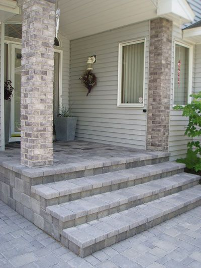 Covering the old front stoop with paving stones gave this entryway a classy new look.