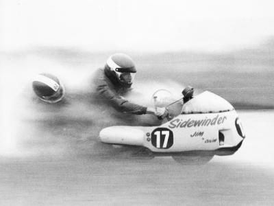 Motorcycle sidecar racing is one of the most extreme motor-sport events. The guts it must take to be the guy hanging off the side into every turn, with total faith in the chap holding the handlebars.