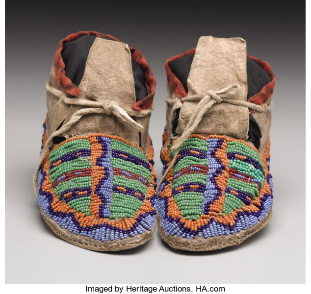 American Indian Art:Beadwork, A PAIR OF SIOUX CHILD'S BEADED HIDE MOCCASINS. c. 1890. ... (Total:2 Items)