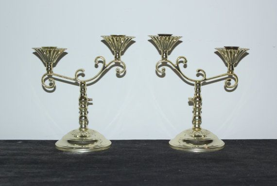 Pair of gold lightweight metal double arm candlestick holders by Home Interiors & Gifts.  Dimensions: 8.5 tall, 7.75 wide across top  If youd like