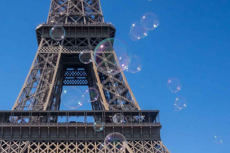 Bubbles drift across the Eiffel Tower in Paris