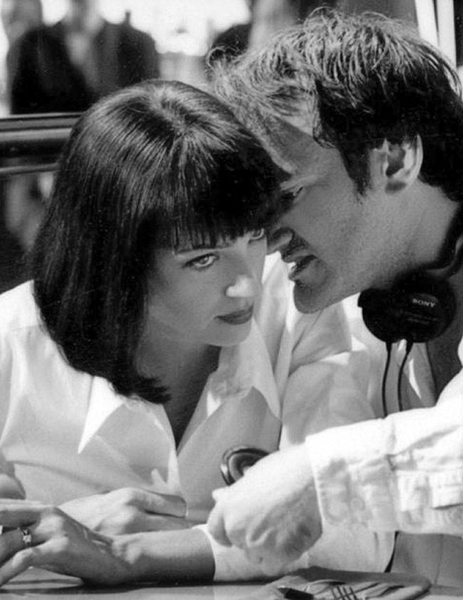 "Uma Thurman and writer-director Quentin Tarantino conferring on the set of ""Pulp Fiction"", 1994."