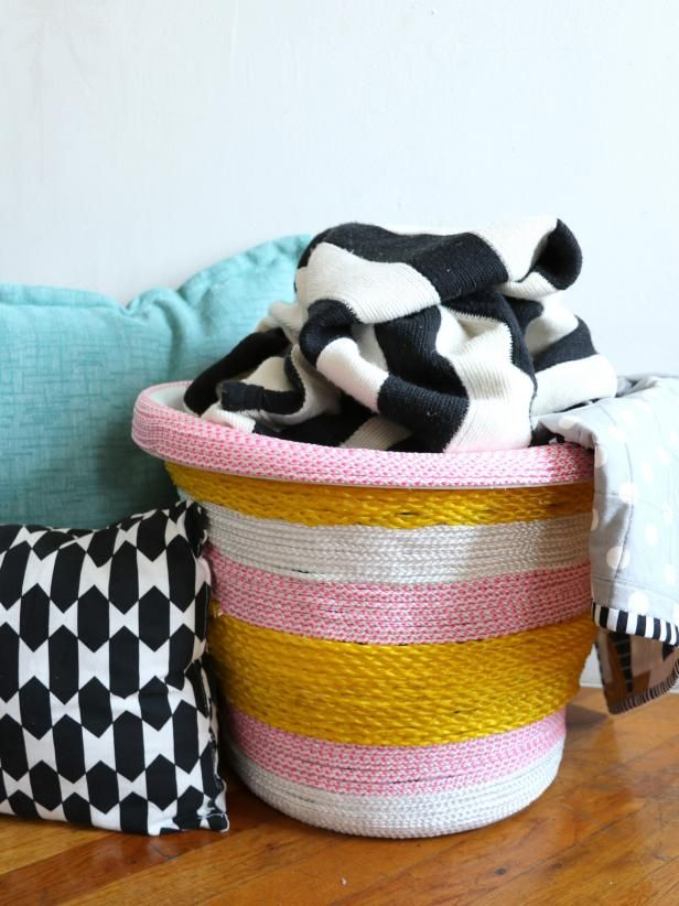 Transform a basic plastic laundry basket with colorful rope and a hot glue gun. Get the easy step-by-step instructions at HGTV.com.