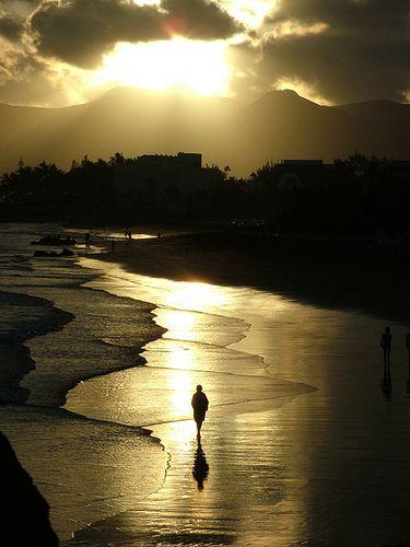 A walk on the beach in Puerto del Carmen Lanzarote by Derek Mc Kenna