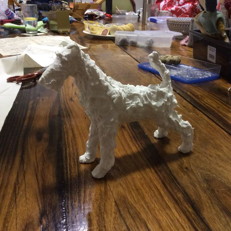 Fox terrier paper clay sculpture. I'll enlarge his head I think. And he'll be painted