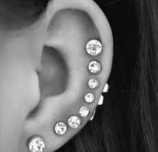 Resultado de imagen para aritos en la oreja mujer