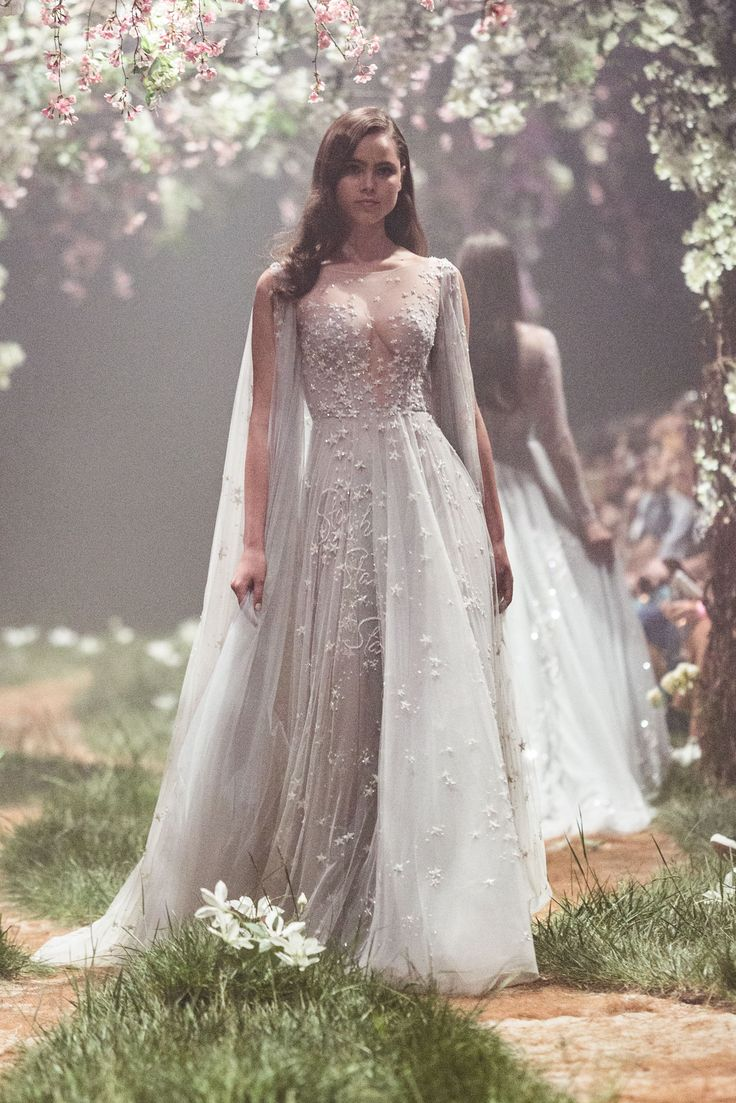 "PSS/S1814 – Caped gown with starlight embroidery, featuring a passage from Pinocchio. ""Starlight, star bright, first star I see tonight. I wish I may, I wish I might. Have the wish I wish tonight."""