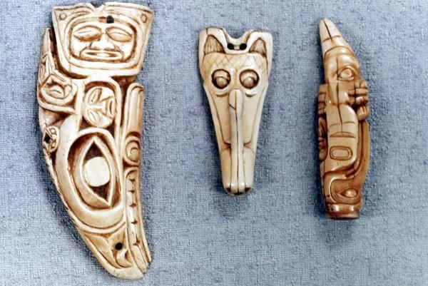 Shaman amulets in images of sea monster, wolf with extended tongue, and charm in form of raven and bear.