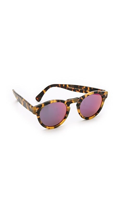 Illesteva Leonard Mirrored Sunglasses | These Illesteva Leonard sunglasses have a glossy tortoiseshell frame. Mirrored lenses. Hardshell case and soft pouch included.  Round frame. Non-polarized lenses. Made in Italy. Measurements |  Width: 5.25in / 13.5cm Height: 2in / 5cm Lens Width: 48mm