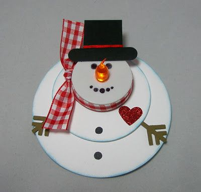 Melted Snowman~ This cute thing could be used as a gift tag, table decoration or an ornament. It is made with paper punches and a battery operated tea light is the nose. Wouldn't this be so cute hanging on a tree? SOOO cute I'm thinking this will great gifts that my grandson's could make.