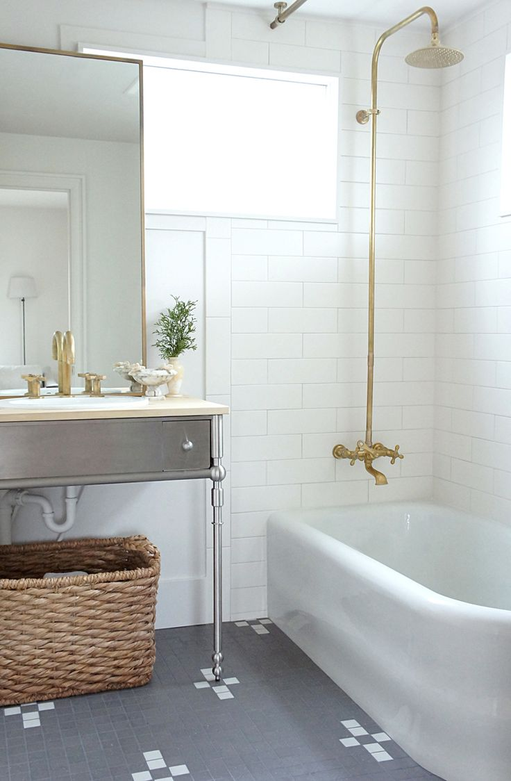 MAKE KING: White bathroom with antique brass fixtures and stainless vanity.