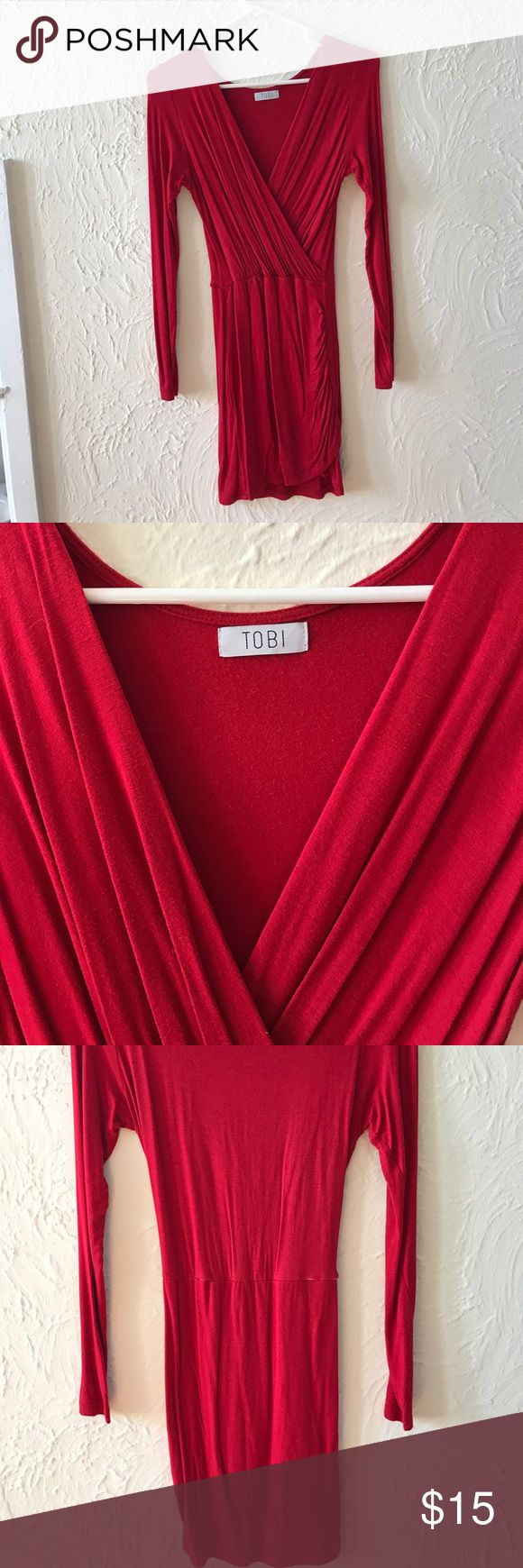 tobi red party dress This is such a great night out dress! I've always received tons of compliments when I have worn it. As you can see in one of the pics the threading has came undone and exposed some of the elastic. It doesn't affect the dress in any way in my opinion. Tobi Dresses Long Sleeve