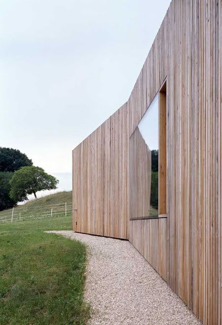 Sculptured in wood and fitting in with the topography of the orchards, this house reminds the world of a hangar and of a barn. It also pres...