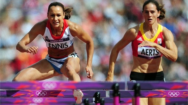 Jessica Ennis of Great Britain and Sara Aerts of Belgium compete in the Women's Heptathlon 100m Hurdles Heat 1 on Day 7 of the London 2012 Olympic Games.