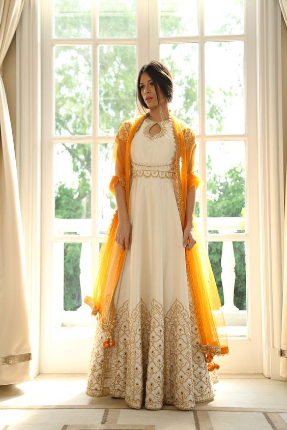 Trending dupatta draping styles for brides | Indian Bridal fashion | Draping dupatta like a jacket | White floor length anarkali | white anarkali with golden work and yellow dupatta | Pernia's Pop-up shop | Every Indian bride's Fav. Wedding E-magazine to read. Here for any marriage advice you need | www.wittyvows.com shares things no one tells brides, covers real weddings, ideas, inspirations, design trends and the right vendors, candid photographers etc.