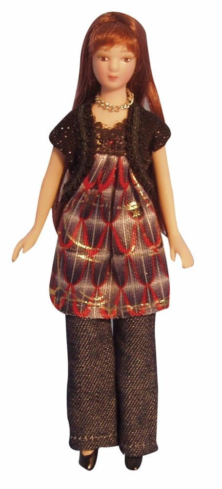 This modern lady is made of porcelain with arms jointed at the shoulders and legs jointed at the hips, she also has a hair wig. She is dressed in denim jeans with a black/silver, multi coloured smock top and comes with her own stand. | eBay!