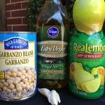 Grab a can of garbanzo beans, olive oil, garlic and a food processor...for less than $1 you can make your own hummus! Easy hummus recipe: