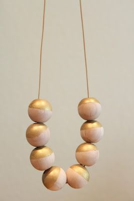"Easy ""dipped"" wood bead necklace (Maybe use a tangerine color on the dark wood beads I have.)"