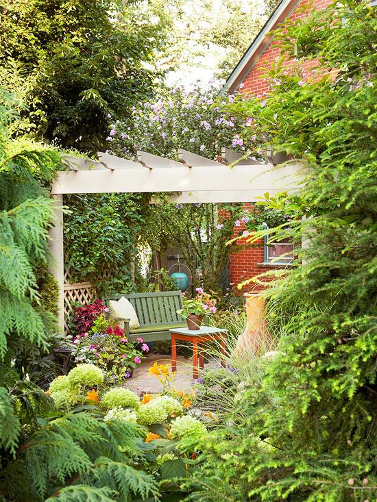 Create a Nook, charming example of how you can add a peaceful getaway in your yard. The pergola is tucked in among evergreens and other trees. The house shields it from view from the back.