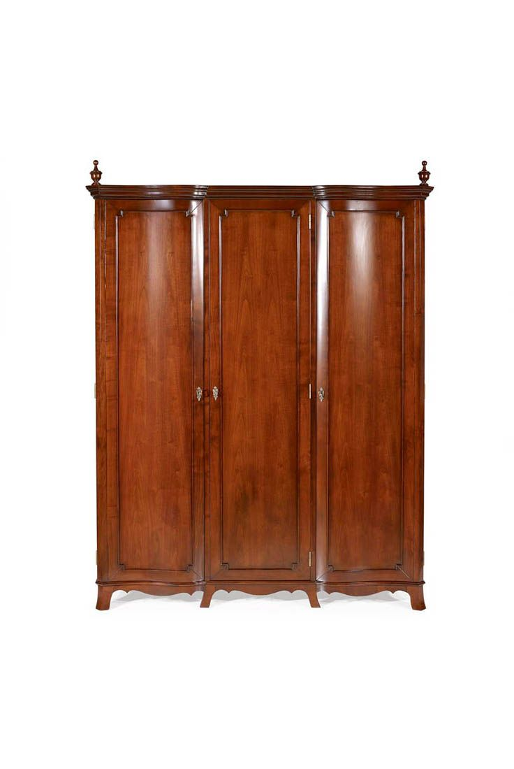 Shown in Cherry wood with an Avignon finish, the Knight wardrobe is a classic triple wardrobe with an assortment of drawers, shelves and railing. Available in internal layout.