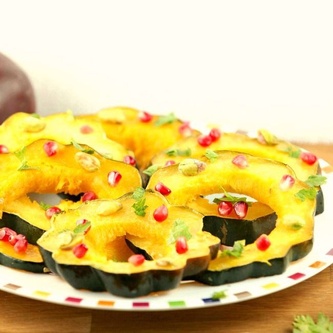 So gorgeous for Thanksgiving! Healthy Roasted Acorn Squash with Pomegranate and Pistachios -low calorie, vegetarian side dish