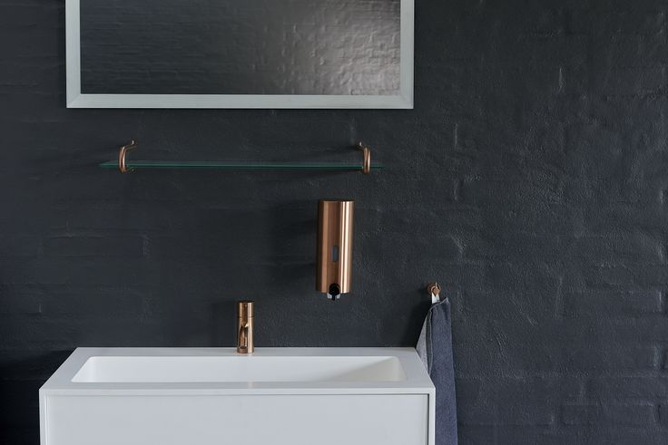 d line bathroom accessories in sleek copper.