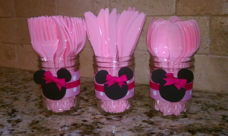 Plasticware in Minnie Mouse jars. Just black construction paper and ribbon
