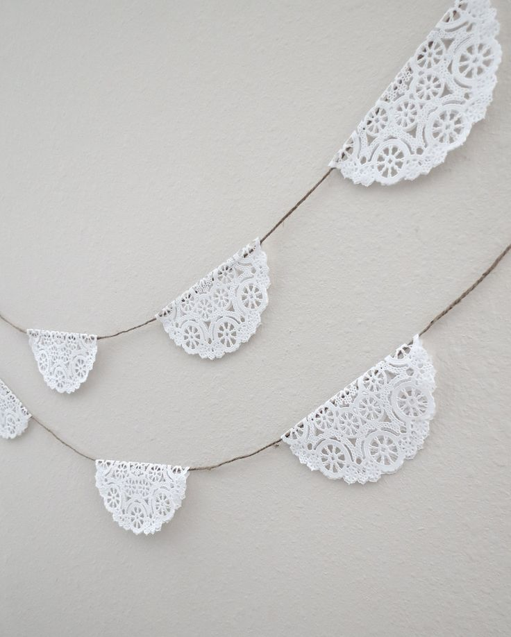 This is what I want for decorations around house: Lace Doily Garland - DIY! Dollar store doilies. fold in half & tape together onto white twine or ribbon. voila! cheap, pretty garland to decorate whole house!!!!