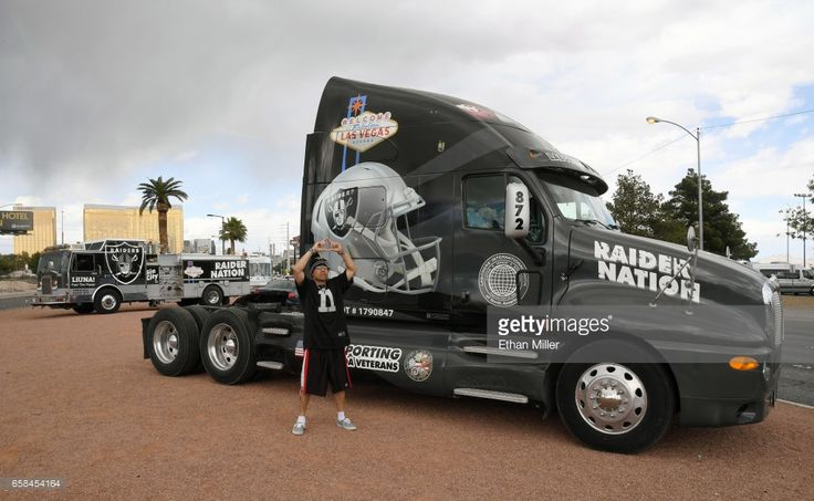 Oakland Raiders fan Nelson Aburto of California poses in front of a semi truck and fire engine emblazoned with Raiders logos near the Welcome to Fabulous Las Vegas sign after National Football League owners voted 31-1 to approve the team's application to relocate to Las Vegas during their annual meeting on March 27, 2017 in Las Vegas, Nevada. The Raiders are expected to begin play no later than 2020 in a planned 65,000-seat domed stadium to be built in Las Vegas at a cost of about USD 1.9…
